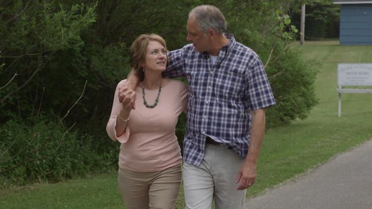 A husband and wife walk together